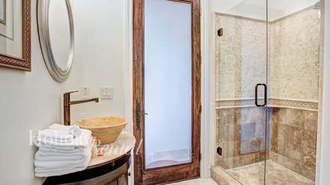 Full bathroom outside of Bedroom 2. Stand up shower, sink and toilet