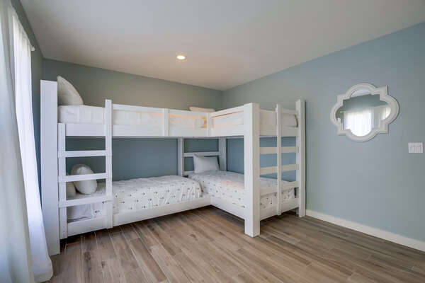 Image of Two Wooden Bunk Beds in Bedroom.