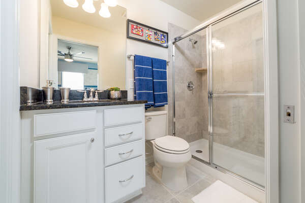 En suite bathroom continues theme with walk-in shower