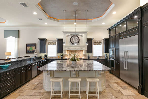 Spacious gourmet kitchen with large island offering more counter space