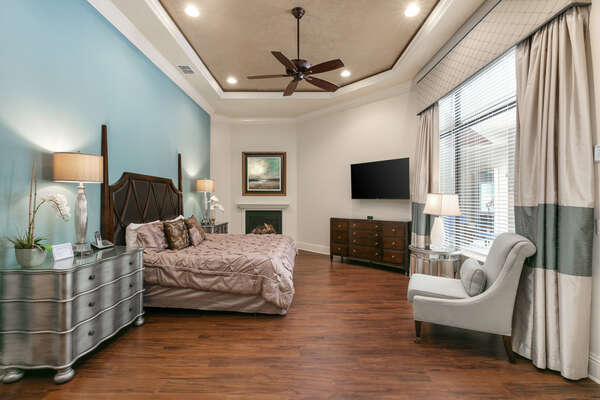 This Main floor Master suite features a king bed, en-suite bathroom, and SMART TV