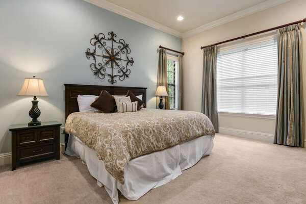 This master suite features a king size bed and en-suite bathroom