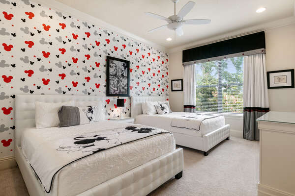 A luxurious bedroom with two comfortable full beds