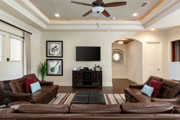 An additional gathering area with SMART TV and game console