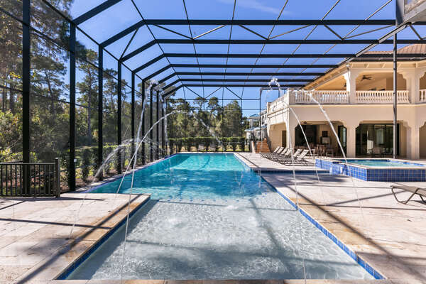 Custom water features in the pool will make you want to swim all day