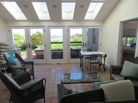 Relax in the bright and airy sunroom -There is a game table as well and the master bedroom is located just to the right! 117 Old Wharf Road Chatham Cape Cod - New England Vacation Rentals