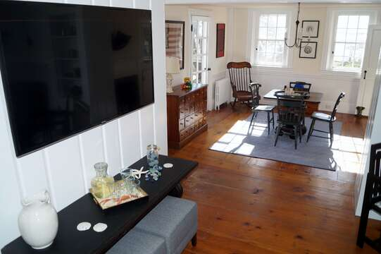The living room opens up to a game room - 117 Old Wharf Road Chatham Cape Cod - New England Vacation Rentals