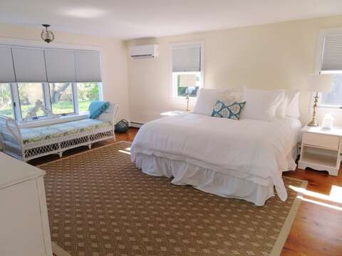 1st Floor MAster Bedroom-Relax on the chaise lounge in the master while enjoying the view! Slim line A/C unit to keep you nice and cool-117 Old Wharf Road Chatham Cape Cod - New England Vacation Rentals