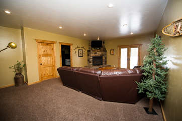 Downstairs family room is the perfect place for a movie night.