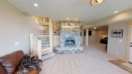 Another gorgeous fireplace in the basement.