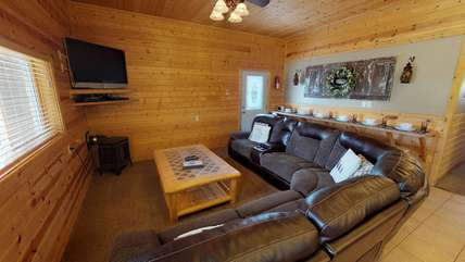 With plenty of seating in this cozy living room your whole family can watch a game or movie together.
