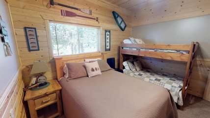 Bedroom 1 has a queen bed as well as a bunkbed.