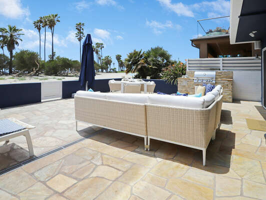 Ground Floor Patio w/ Outdoor Dining, Seating, Lounge Chairs, Large Umbrella & BBQ