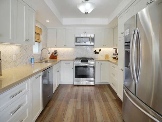Fully Equipped Kitchen with Plenty of Counter Space - First Floor