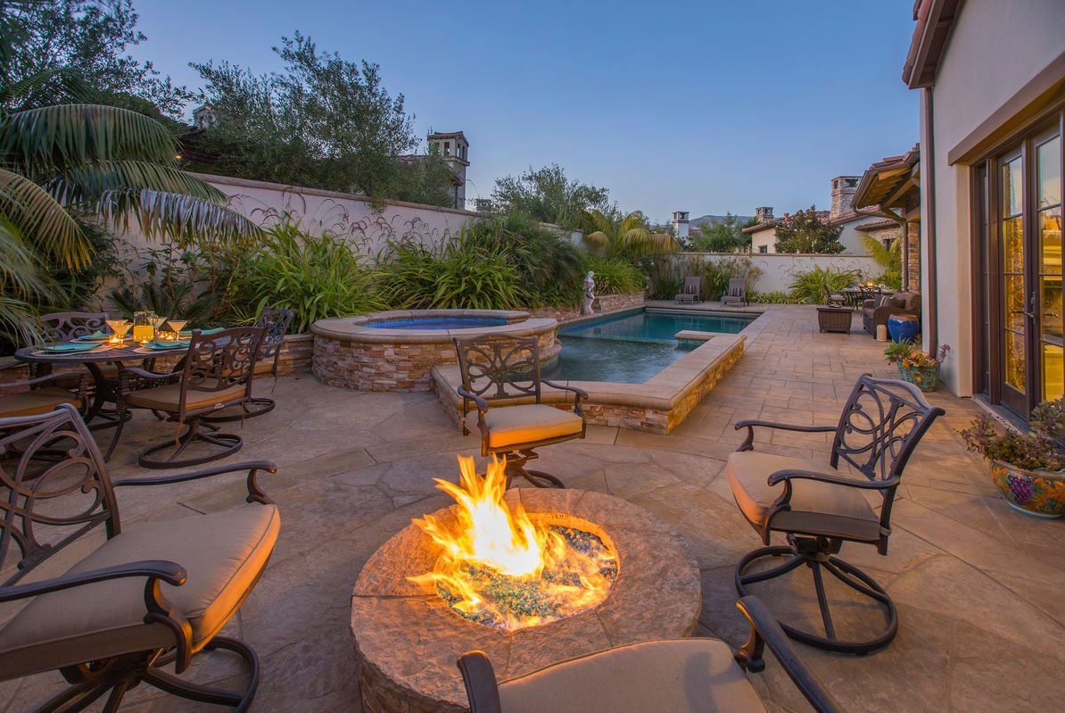 Stay warm by the outdoor firepit in the Backyard