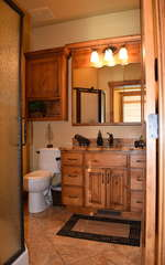 Shared bathroom by kitchen