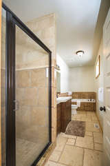 Along with the bath tub is also a gorgeous tiled shower.