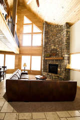 A beautiful fireplace is the perfect center piece for this beautiful cabin.