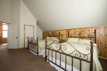 The third bedroom upstairs that has two queen beds.