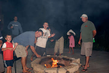 Having fun around the campfire.