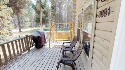 The porch has plenty of seating as well as picnic table to eat outside on a warm summer day.