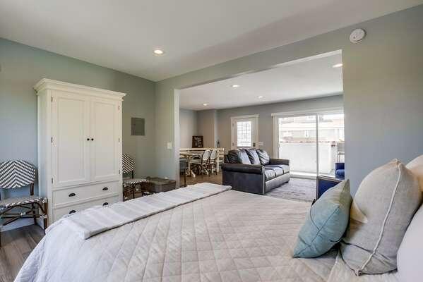 Bedroom Features Queen Bed.