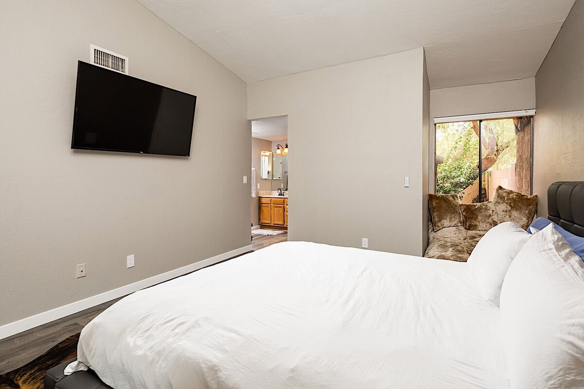 Watch TV from bed or curl up with a good book in this master bedroom during your stay in Scottsdale
