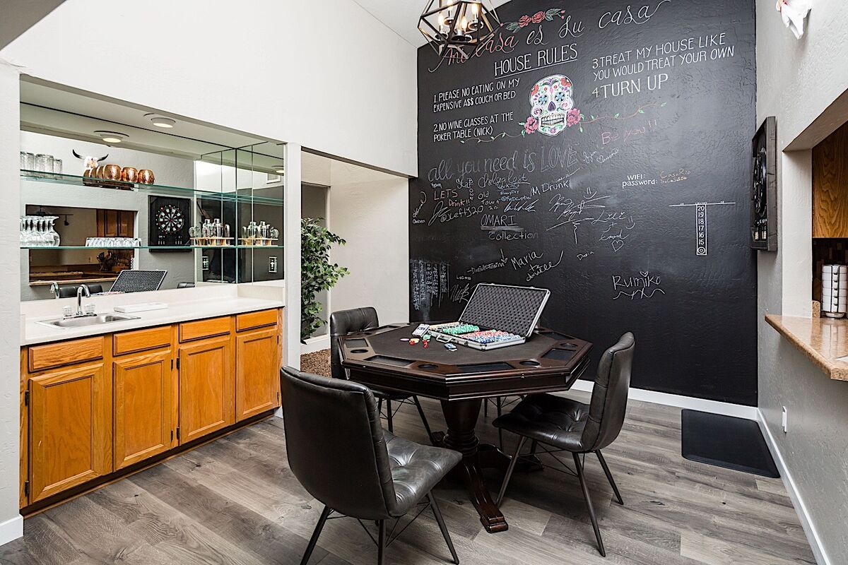 Awesome game room with a chalk board wall to keep score (or entertain the kids!).