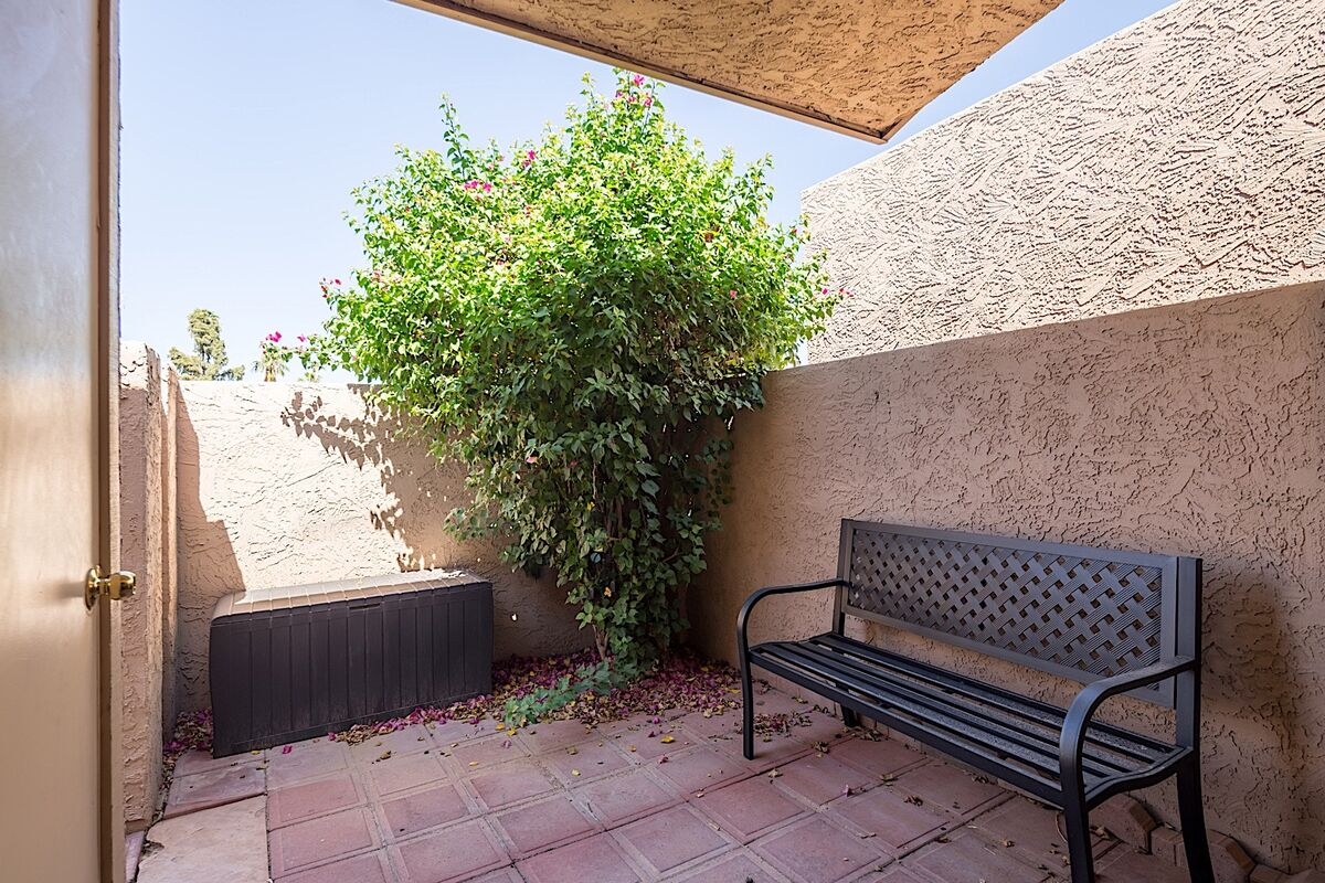 Take a step out to the private patio area to take a breath of fresh air