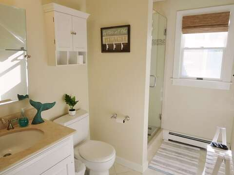 1st floor bathroom off of the hallway with a shower - 66 The Cornfield Chatham Cape Cod - New England Vacation Rentals