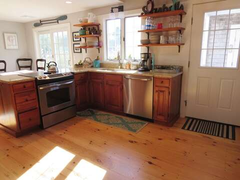 Fully equipped kitchen with dishwasher. The side door opens to the patio with a hot tub - 66 The Cornfield Chatham Cape Cod - New England Vacation Rentals