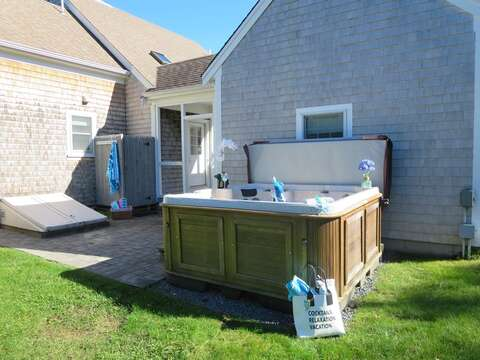 View of the hot tub and outdoor shower on the private side patio - 66 The Cornfield Chatham Cape Cod - New England Vacation Rentals