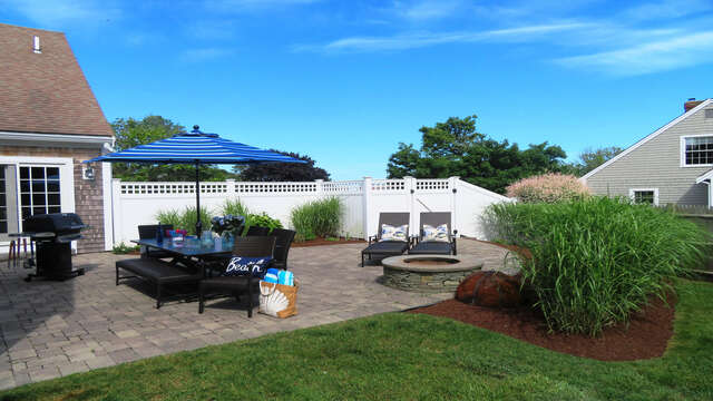 Very private, large patio with fire pit. Outdoor table, chairs, umbrella, and gas grill! - 66 The Cornfield Chatham Cape Cod - New England Vacation Rentals