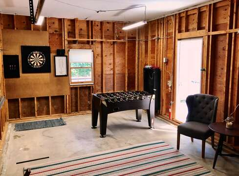 Just inside the garage you will find a little game area- great for the kids! - 66 The Cornfield Chatham Cape Cod - New England Vacation Rentals