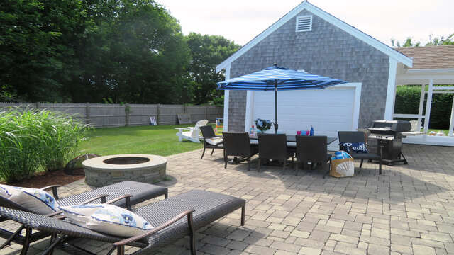 ANother view of the private patio looking to the large back yard- 66 The Cornfield Chatham Cape Cod - New England Vacation Rentals