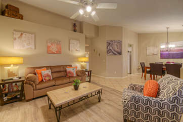 Chic and cozy living room just inside front entrance is perfect gathering spot and has queen sleeper sofa for an additional sleeping option