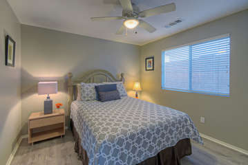 Third bedroom is also separated from master suite and features a queen bed and television