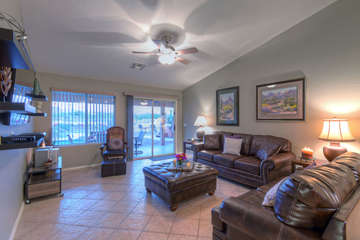 Great room has doors to back patio and is comfortable place to relax with your favorite people