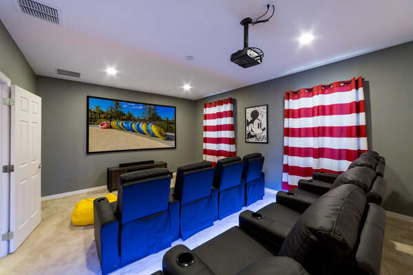 Mickey Mouse Themed Theater Room with Stadium Seating