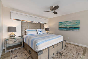 Master bedroom has a King bed and ceiling fan