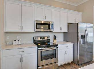 Spacious open-concept kitchen with high-end amenities and appliances. Toaster oven, microwave, cutlery, pots and pans all provided. A standard coffee maker, blender, sheet trays, etc. all provided as well.