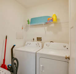 Fully functional and stocked laundry room.