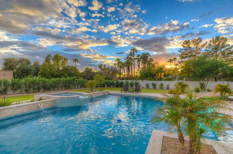 Image of Large Pool and Hot Tub in Backyard.