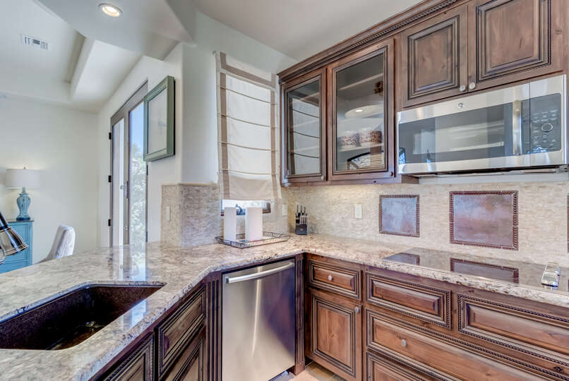 Enjoy Stainless-Steel Appliances in Kitchen.