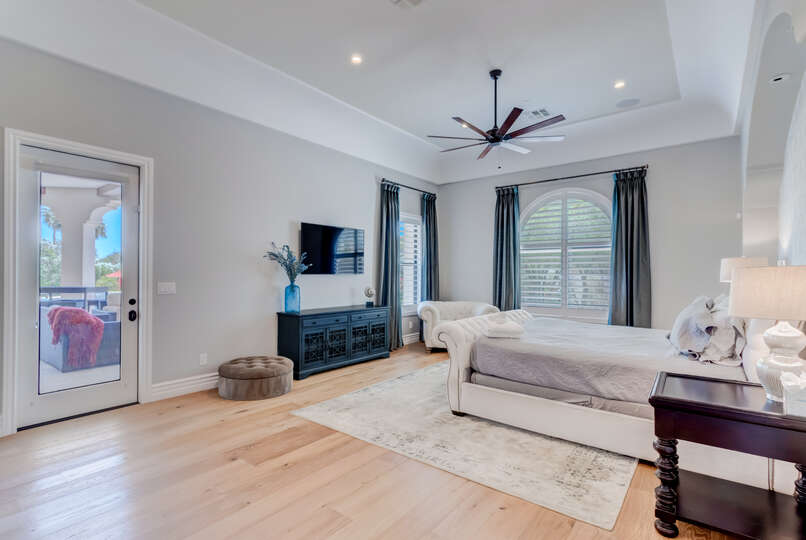 Enjoy a Private Exit to the Backyard from Master Bedroom.
