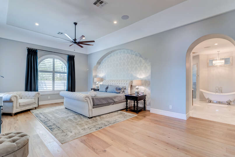 Image of Luxurious Master Bedroom With Bed and Soda.