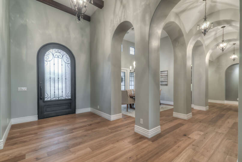 Grand Entry Way With Cathedral-Like Ceilings in the Foyer.
