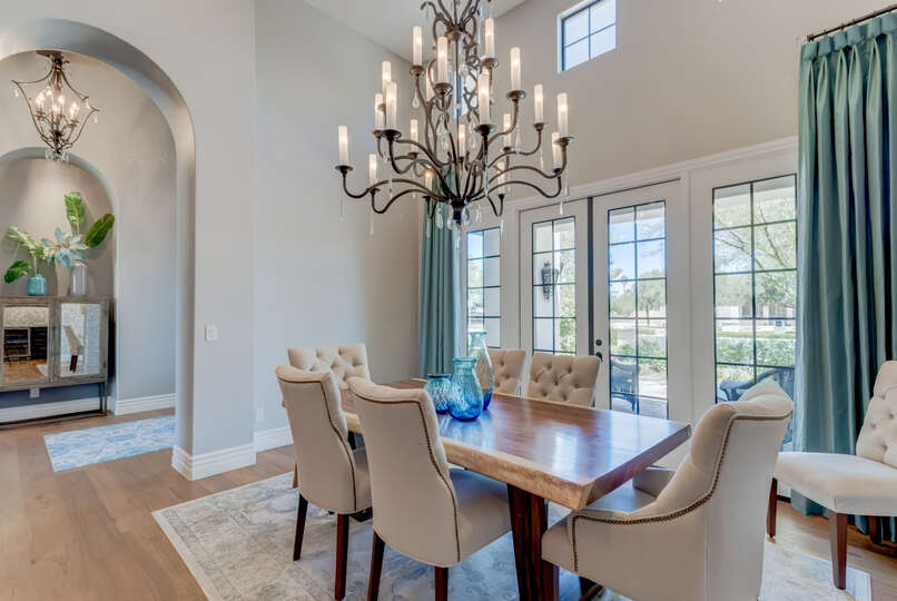 Solid Wood Table and Six Upholstered Chairs in Dining Room.
