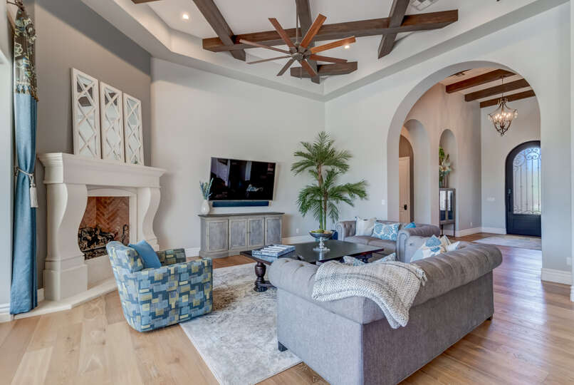 Image of Living Room with Sofas and TV Mounted on Wall in Scottsdale Vacation Home Rental.
