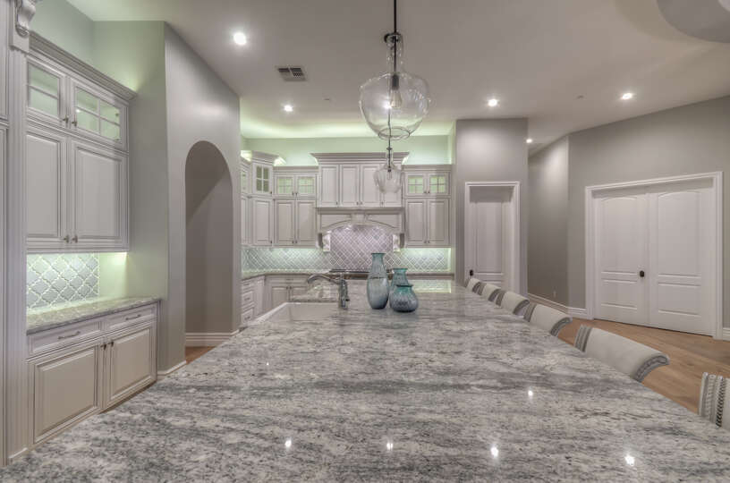 Beautiful Kitchen Island with Bar Stools in Scottsdale Vacation Home Rental.